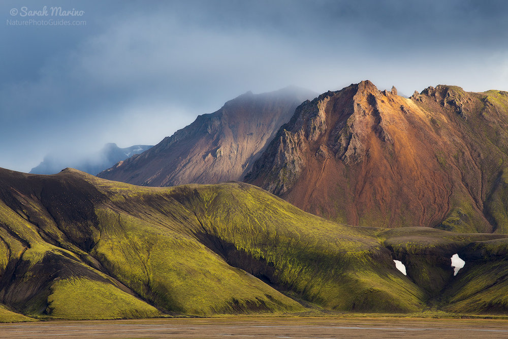 A clearing storm allowed a bit of light to peek through and illuminate these colorful mountains in Iceland's remote Landmannalaugar region.