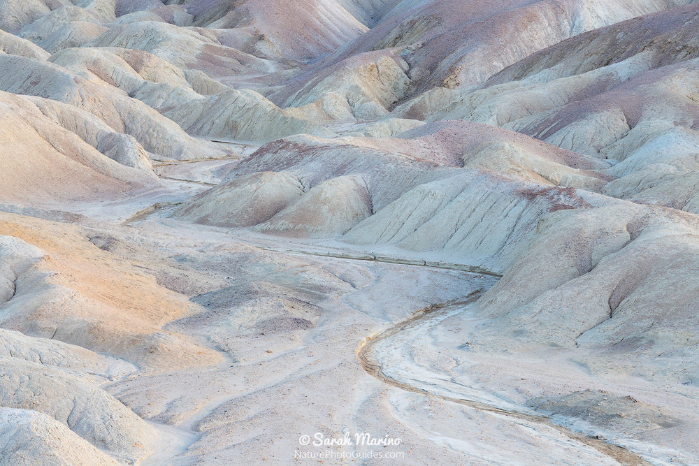 Pastel badlands at twilight in Death Valley National Park.