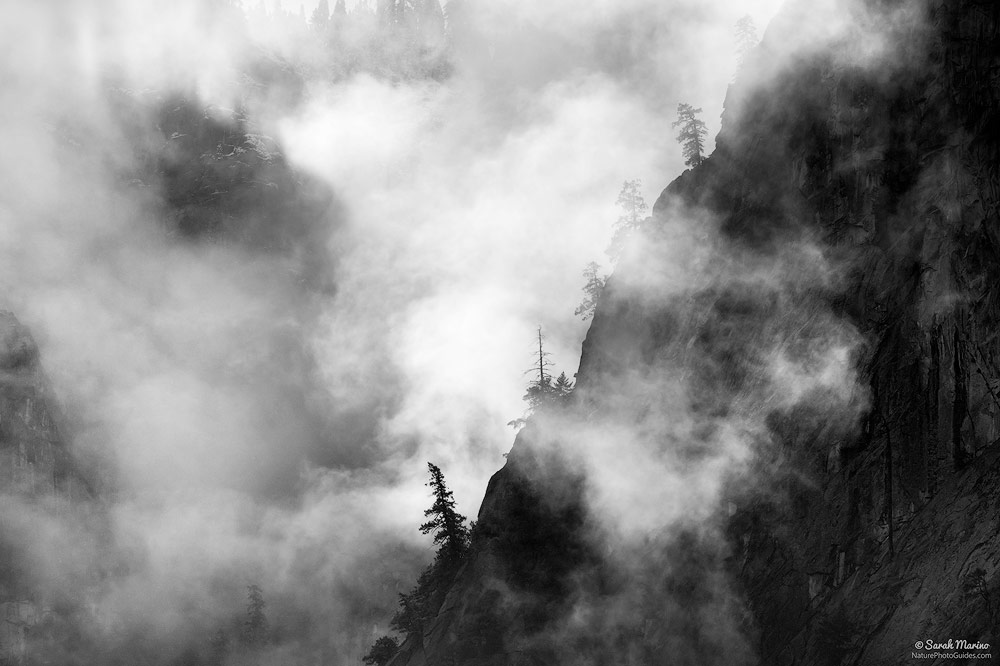 A storm clears from the high cliffs surrounding Yosemite Valley in Yosemite National Park, California.