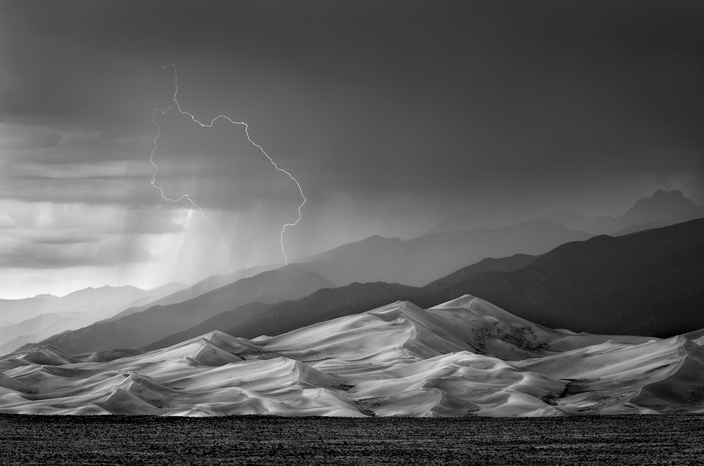 Stormy Sand Dunes: This is a photo that I first processed in color but now prefer in black and white. When stripped of color, the core elements shine through to a greater degree and I decided to take more liberty in bringing out the drama of the scene for this version.