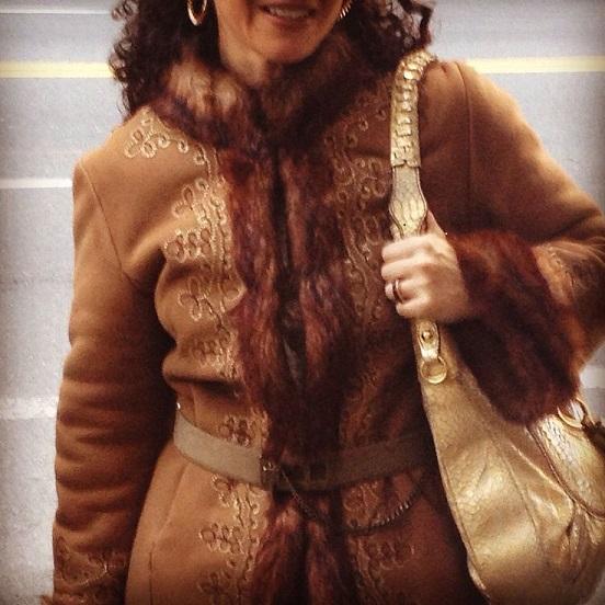 75 Belted, embroidered coat with fur trim, gold bag.jpg