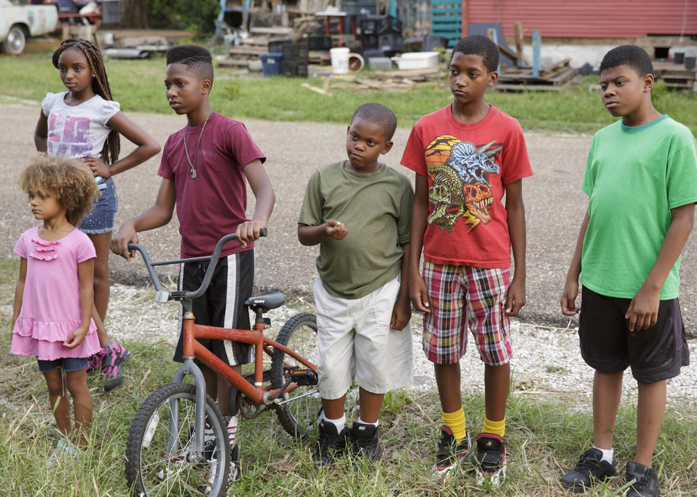 Some of our great neighborhood kids from The Lot with one of our leads, Navoj Decay (with bike) who played Sonny.