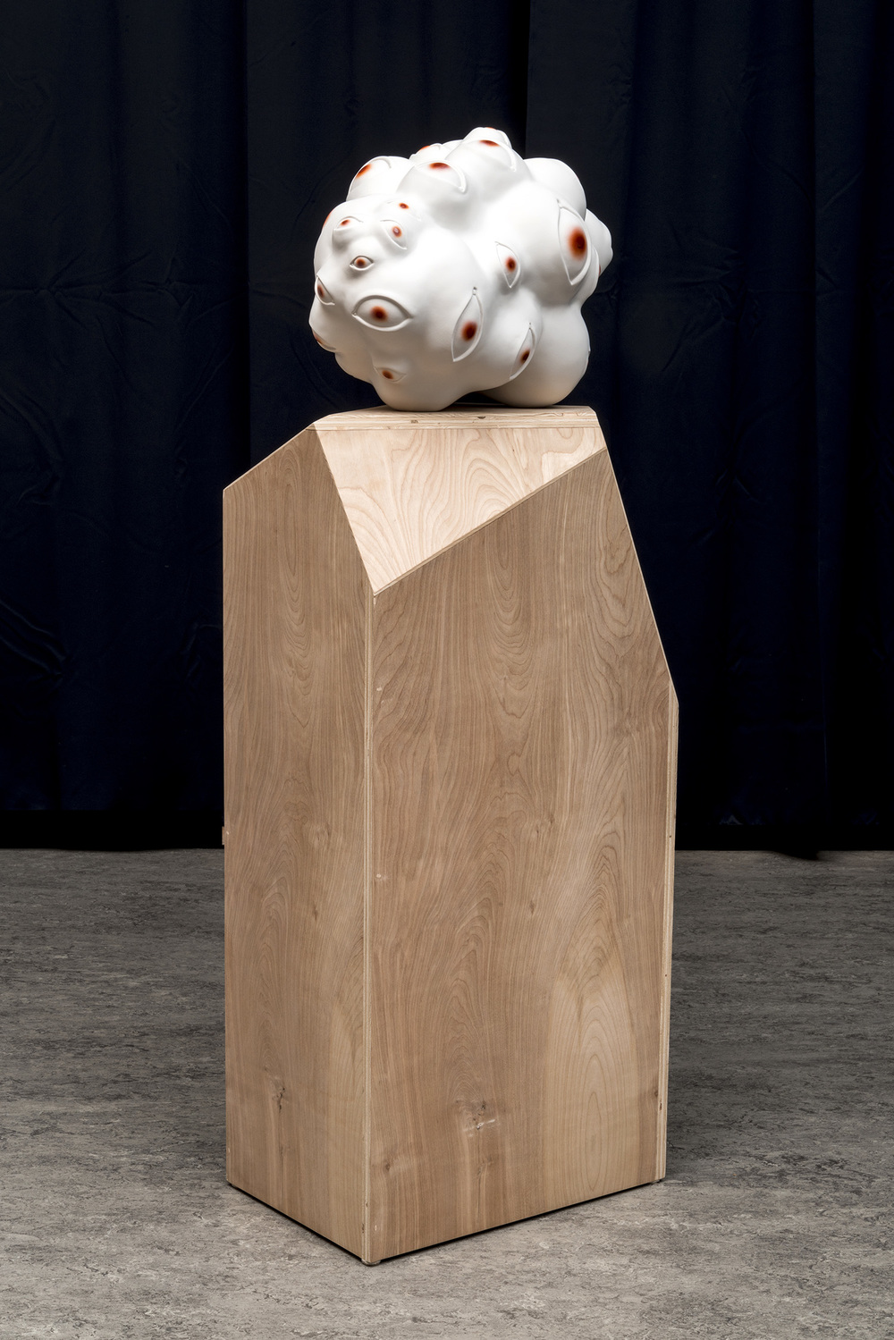 """Tanya Batura  Untitled (eye blob)  2014 Clay, acrylic 14 x 12 x 18 inches 54 x 13 x 19 inches with pedestal Courtesy of 101/Exhibit Photography: Alan Shaffer          Normal   0           false   false   false     EN-US   X-NONE   X-NONE                                                                                                                                                                                                                                                                                                                                                                                 /* Style Definitions */  table.MsoNormalTable {mso-style-name:""""Table Normal""""; mso-tstyle-rowband-size:0; mso-tstyle-colband-size:0; mso-style-noshow:yes; mso-style-priority:99; mso-style-qformat:yes; mso-style-parent:""""""""; mso-padding-alt:0in 5.4pt 0in 5.4pt; mso-para-margin-top:0in; mso-para-margin-right:0in; mso-para-margin-bottom:10.0pt; mso-para-margin-left:0in; line-height:115%; mso-pagination:widow-orphan; font-size:10.0pt; font-family:""""Cambria"""",""""serif""""; mso-fareast-font-family:""""MS Mincho""""; mso-bidi-font-family:""""Times New Roman"""";}"""