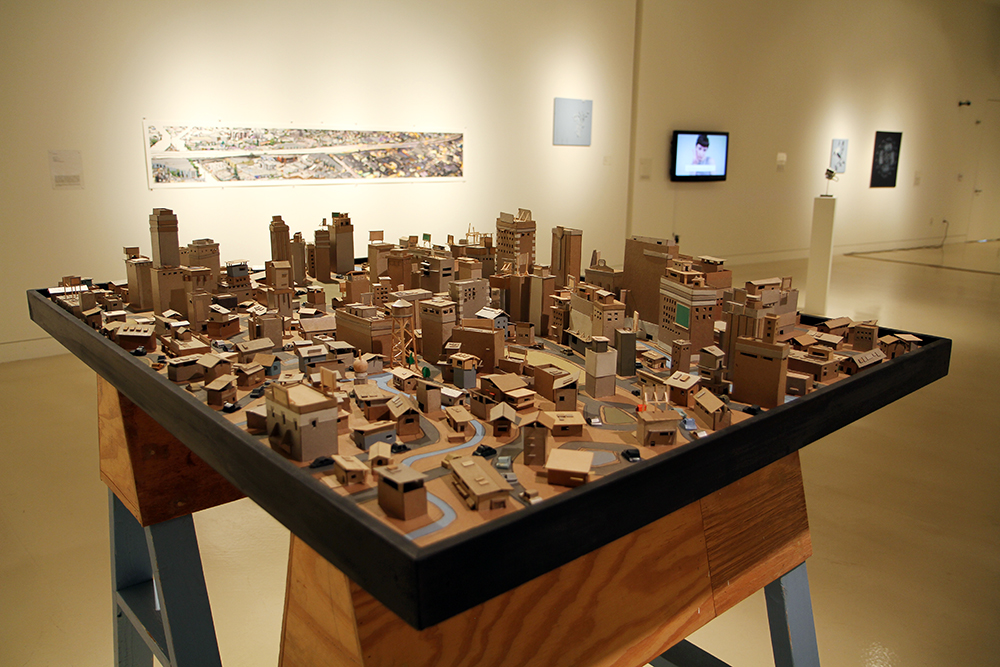 Kiel Johnson  Urban Sprawl Project: River Front  2013 Chipboard and balsa wood 48 x 60 x 60 inches Courtesy of the Artist and Mark Moore Gallery