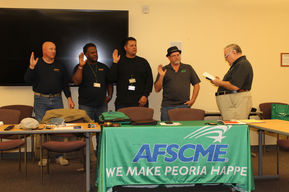Photo by Leslie McMorrow  Leadership oath  AFSCME Local 3282 leaders are sworn in, following November elections. Pictured: Dave Miller (recording secretary), Walter Crenshaw (president), Cesar Orozco (trustee), Erik McMorrow (vice president), Roman Ulman (official). Not pictured: Fran Krugen (treasurer), Domingo Cadena (trustee), Michelle Dobrosky (trustee), Aaron Montano (backup trustee)