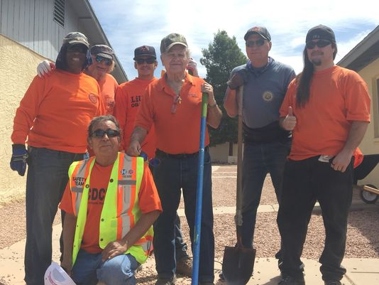 Some of the laborers from the Laborer's Local Union #383 volunteered their time to paint and landscape Whispering Sands affordable housing in north Phoenix, April 27, 2016. (Photo: Claire Cleveland / The Republic)