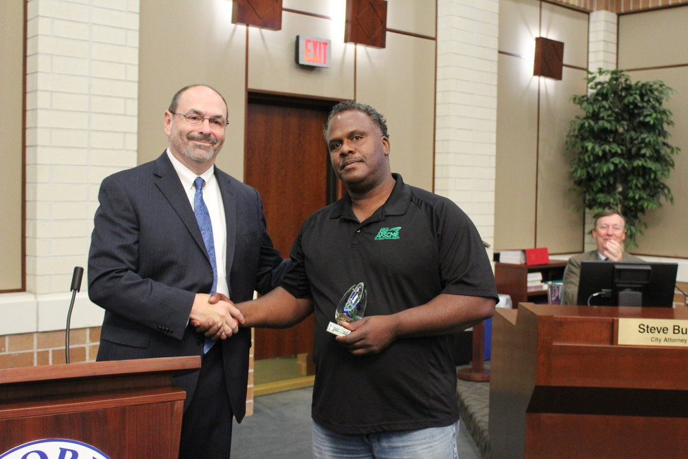 "City Manager Carl Swenson presents the Leadership award to AFSCME Local 3282 President, Walter Crenshaw. Crenshaw accepted the award on behalf of the union members, saying, ""This award belongs to the members. They are the ones who elected me to lead the union, so they are the true winners of the leadership award. I'm just doing what they put me in place to do."""