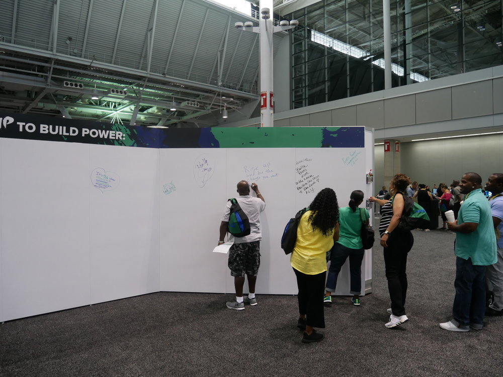 The whiteboard daily message board in the vendor hall.