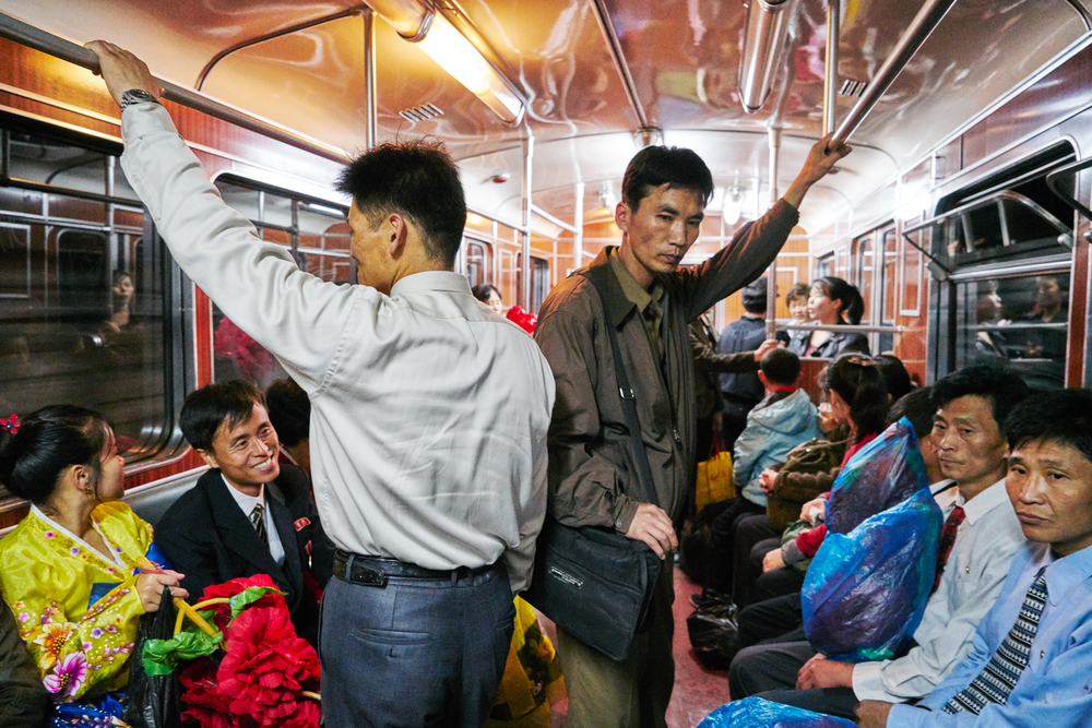 Daily commute inside the Pyongyang metro car.