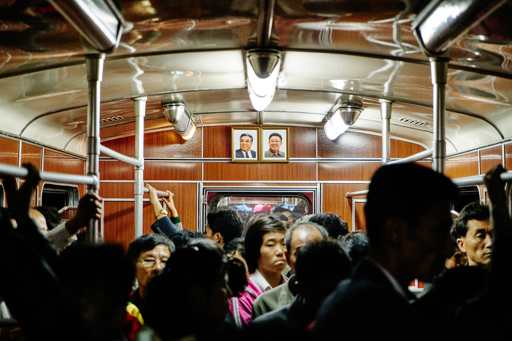 A photo of Kim Il-Sung and Kim Jong-Il hang in every metro car in Pyongyang.