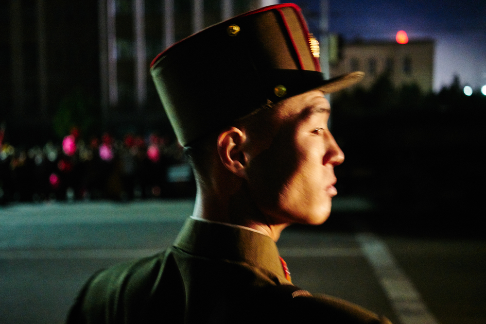 Military keeping us in check so we don't cross the line. Pyongyang, NK.