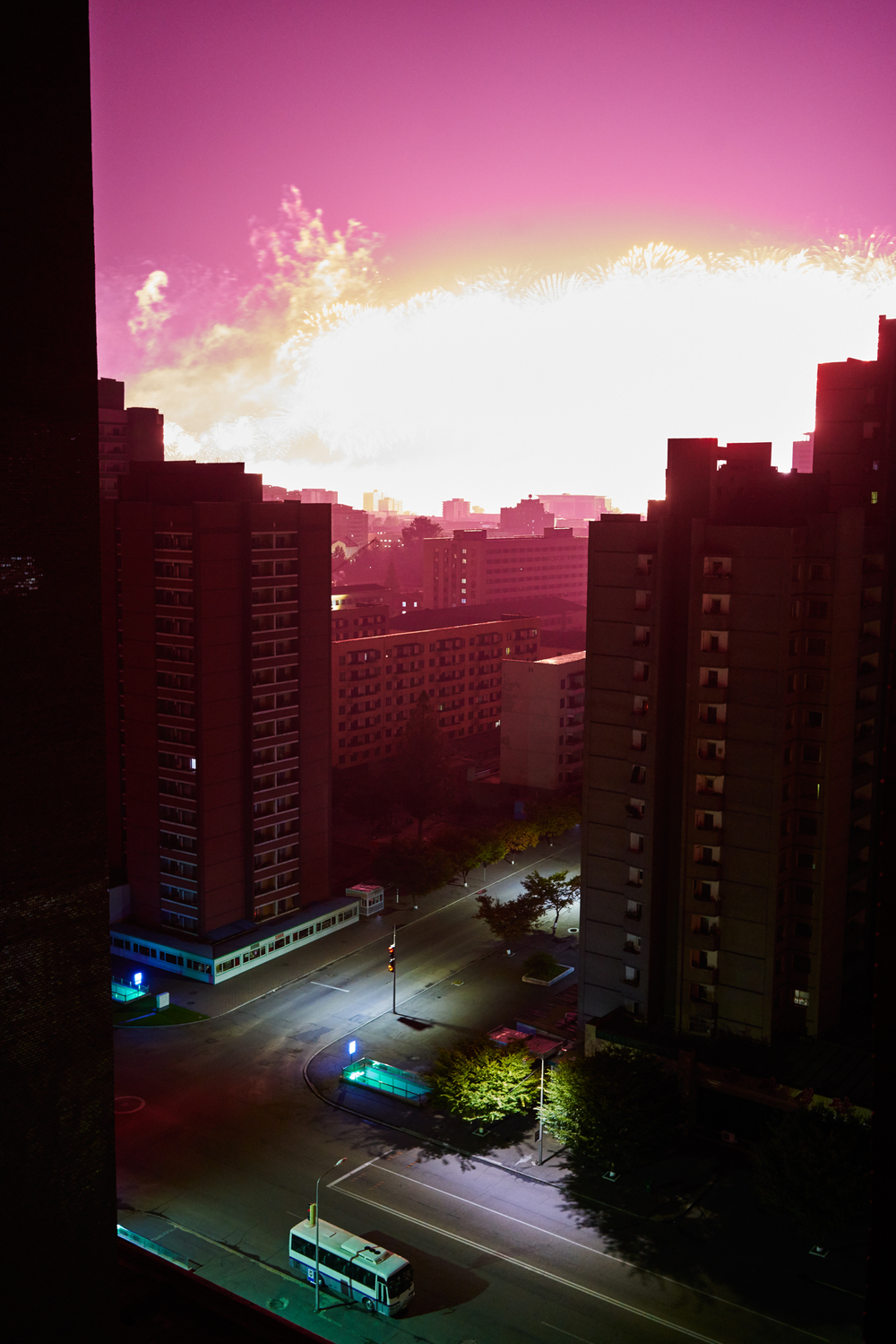 2AM Fireworks display in the distance outside the window of Koryo Hotel.  Pyoungyang, NK