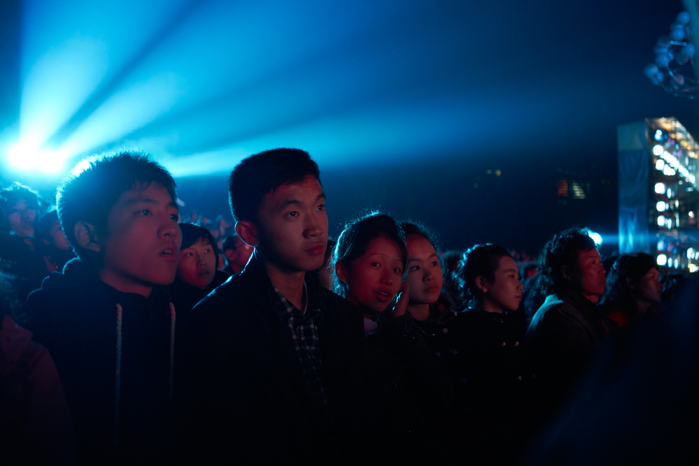 Locals attend the 70th Anniversary concert outside the waterfront of Kim -Il Sung Square. Pyongyang, NK