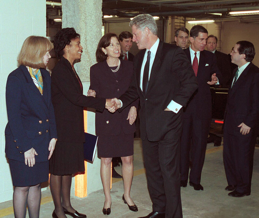 17. President Clinton greets three AT&T Vice Presidents in Oakton, Va.jpg