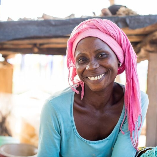 Hi, I'm Agnes - My husband and I sell energy-efficient stoves in order to provide a better future for our seven children. With your support, I'll be able to access a loan and start my own bank account.