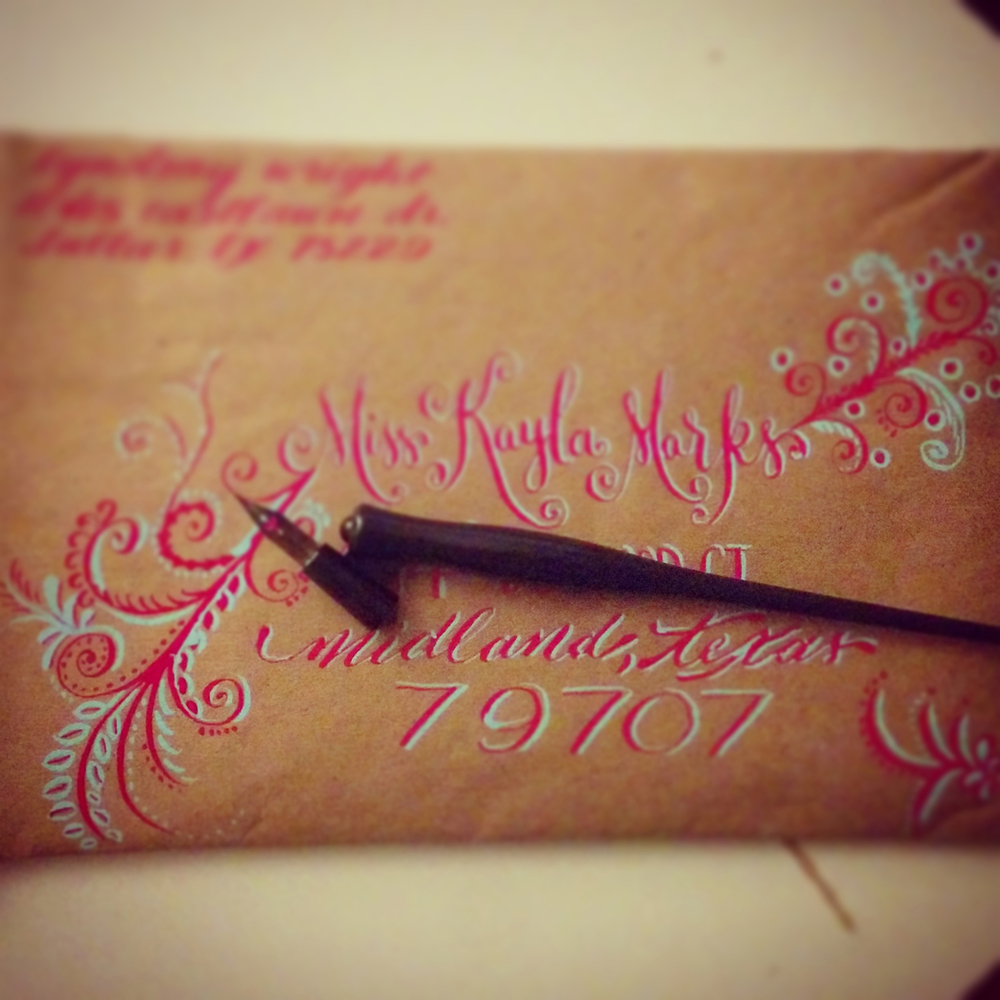 calligraphy-envelope-multiple-lettering-styles-flourished-magenta-tiffany-blue-on-kraft.jpg