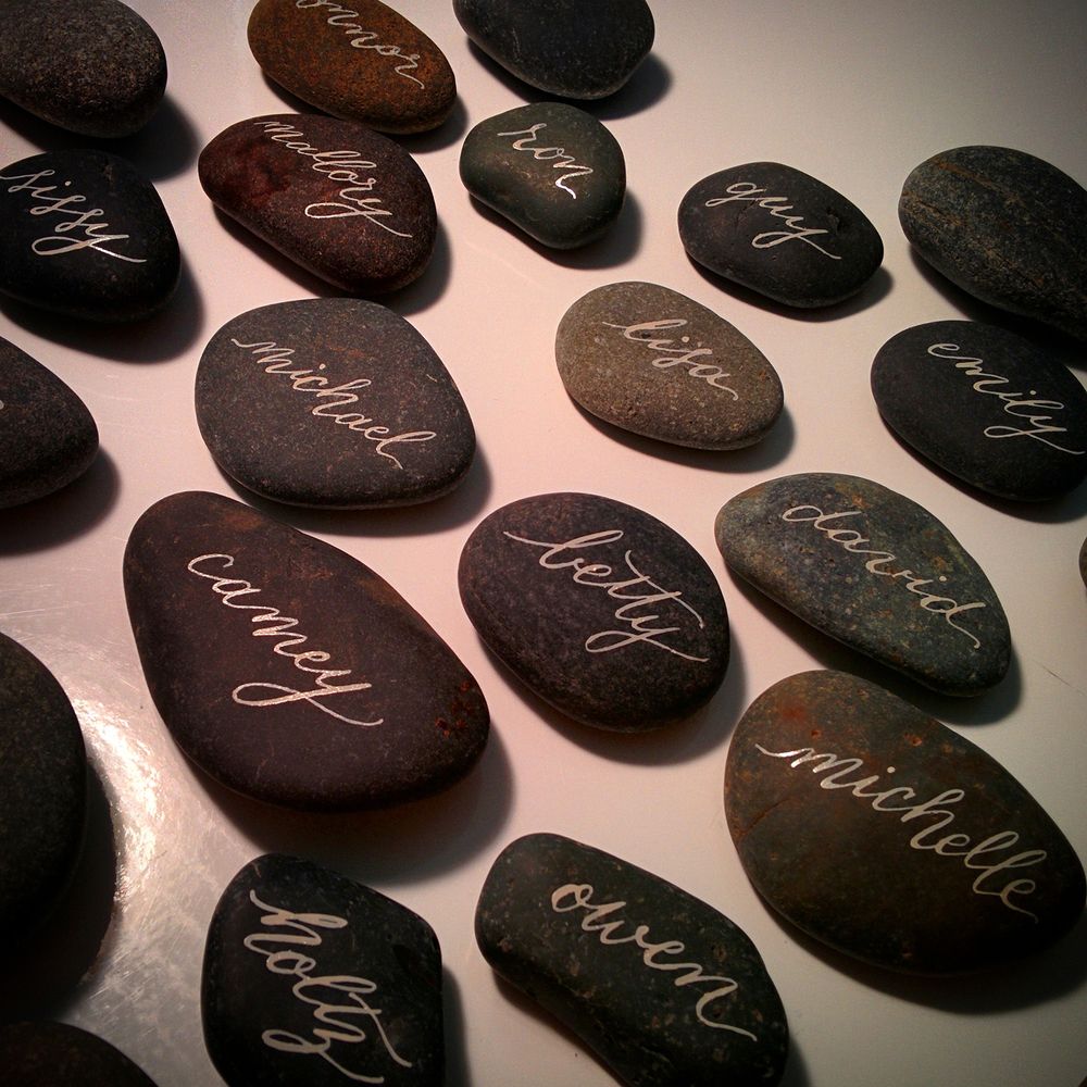 calligraphy-river-rock-place-cards-melbourne-ivory-ink-on-river-rocks.jpg
