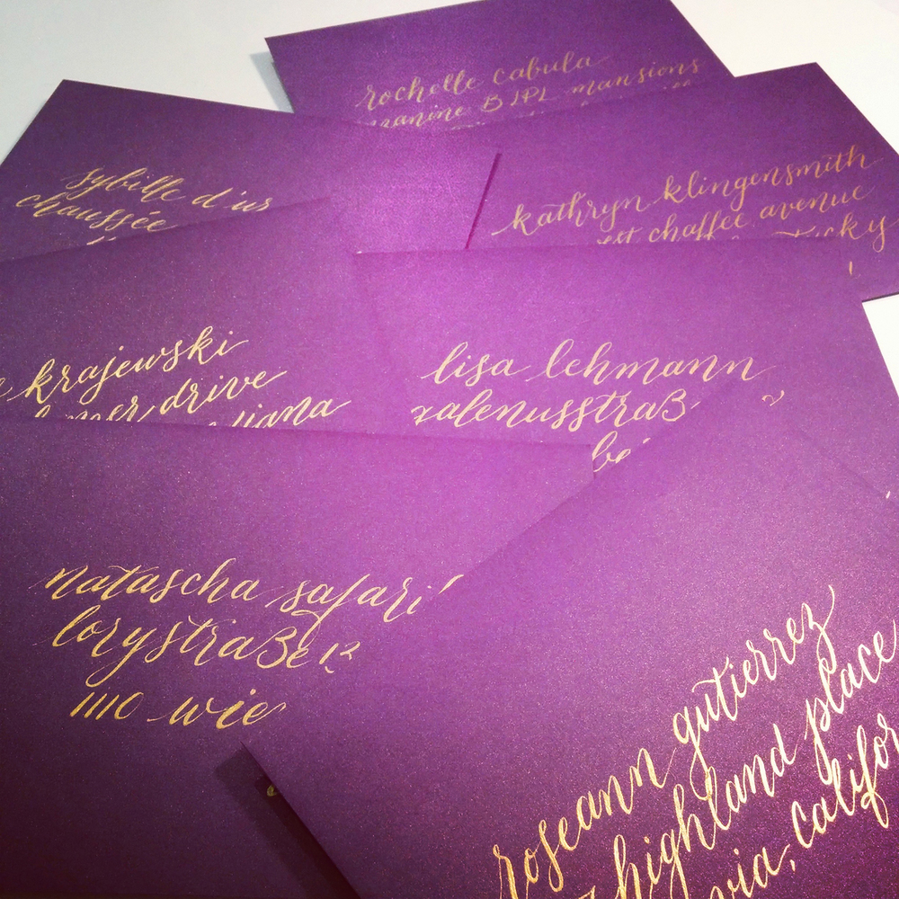 calligraphy-envelope-melbourne-gold-metallic-ink-on-metallic-purple.jpg