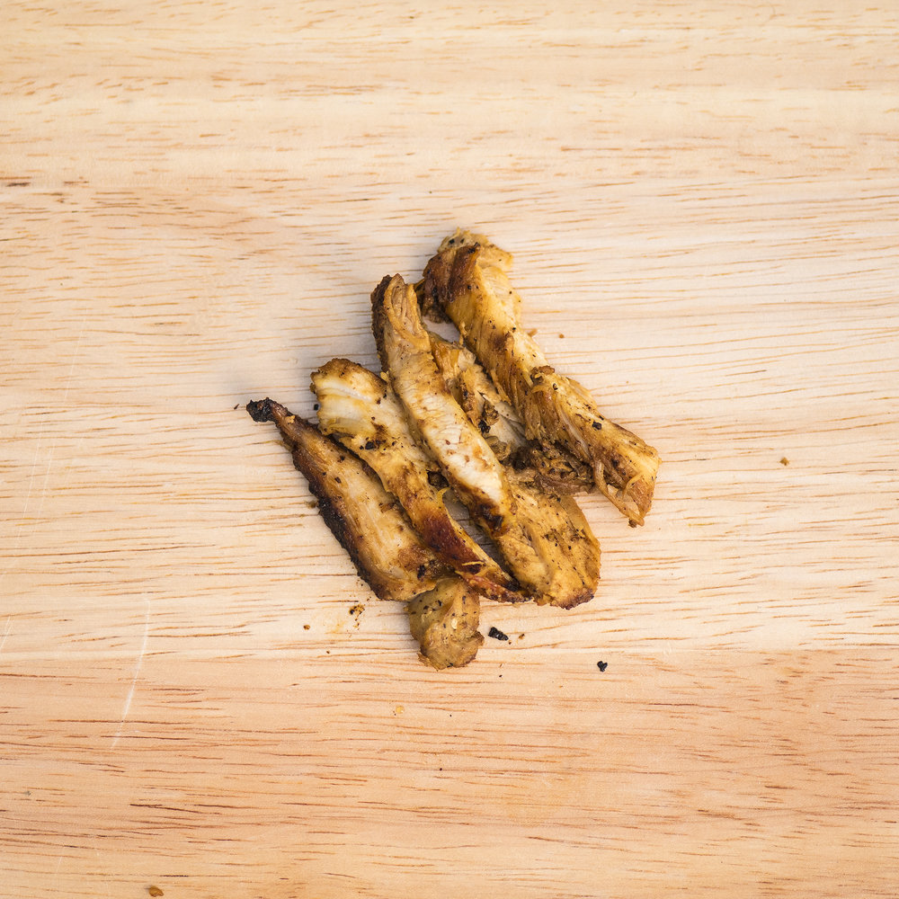seared chicken thigh The building blocks of most Northern Chinese chicken marinades are ginger, rice wine, and salt. We take that as a starting point and add galangal, garlic, cumin, and rice vinegar. The chicken thighs are then split and hard-seared on the griddle.