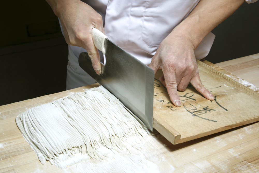 shuji cuts folded soba dough into  noodles.jpg