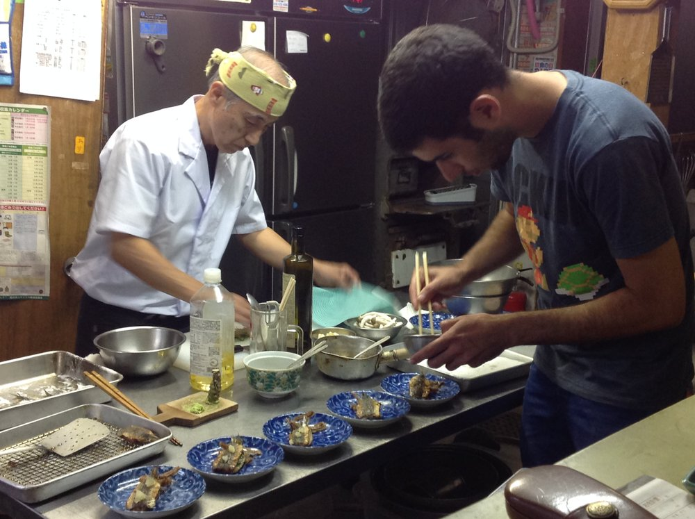 """Together with a visiting Chef Ido Segevfrom Israel, Shuji makes dinner for his parents and friends at his soba noodle restaurant """"Yamakyu""""."""