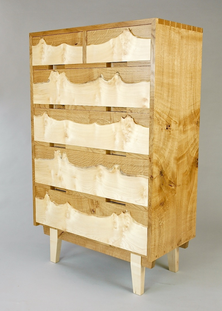 Chest of drawers with natural edge veneers in a Mid Century style.