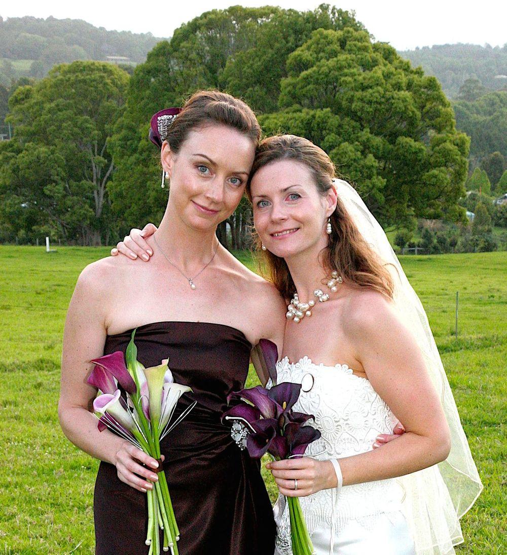 My sister (on the left) and I (the bride).  * Please note my blood shot eye.  Being a bride is VERY exhausting and I also cried when I saw my wedding bouquets because they were so beautiful.  A tad emotional?