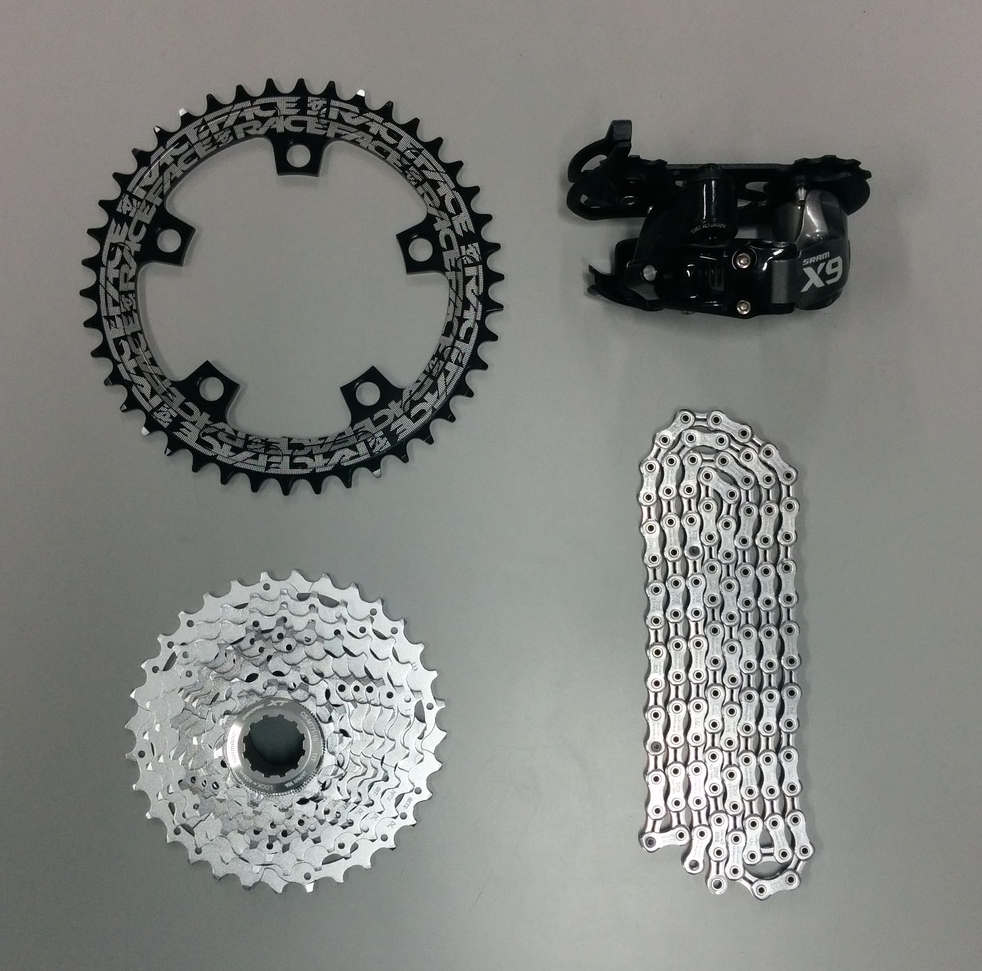 Parts required for the conversion.    From left top(clockwise): Race Face NarrowWide 110bcd 42T ring, Sram X9 Type 2 Medium Cage, Shimano Dura-Ace CN-7900 10sp. chain, Shimano XT 10sp 11-32T Cassette.