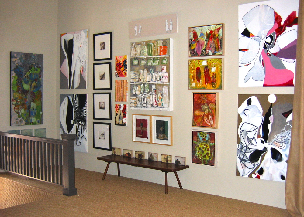 """""""ArtWall"""" created for the opening of Market Place Interiors, featuring a revolving collection of regional artists."""