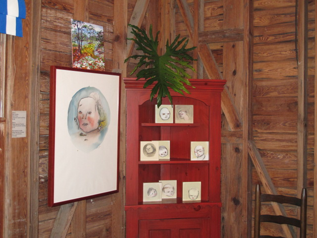 Framed piece on paper by Edgar Sanchez Cumbas; painting on top by Blair Updike; 5x5 wood block paintings on table and in corner unit, Sanchez Cumbas