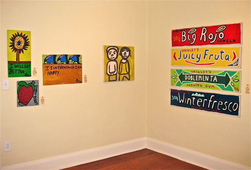 San Rafael pop up gallery in home for sale - folk art works by Ruby C. Williams, on left, and PACO, gum series on right.