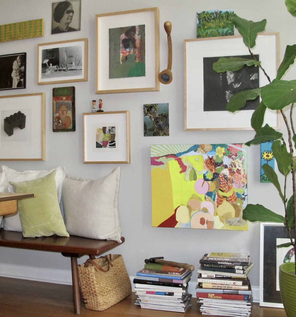 Salon wall of regional art installed for a Tampa Bay area collector