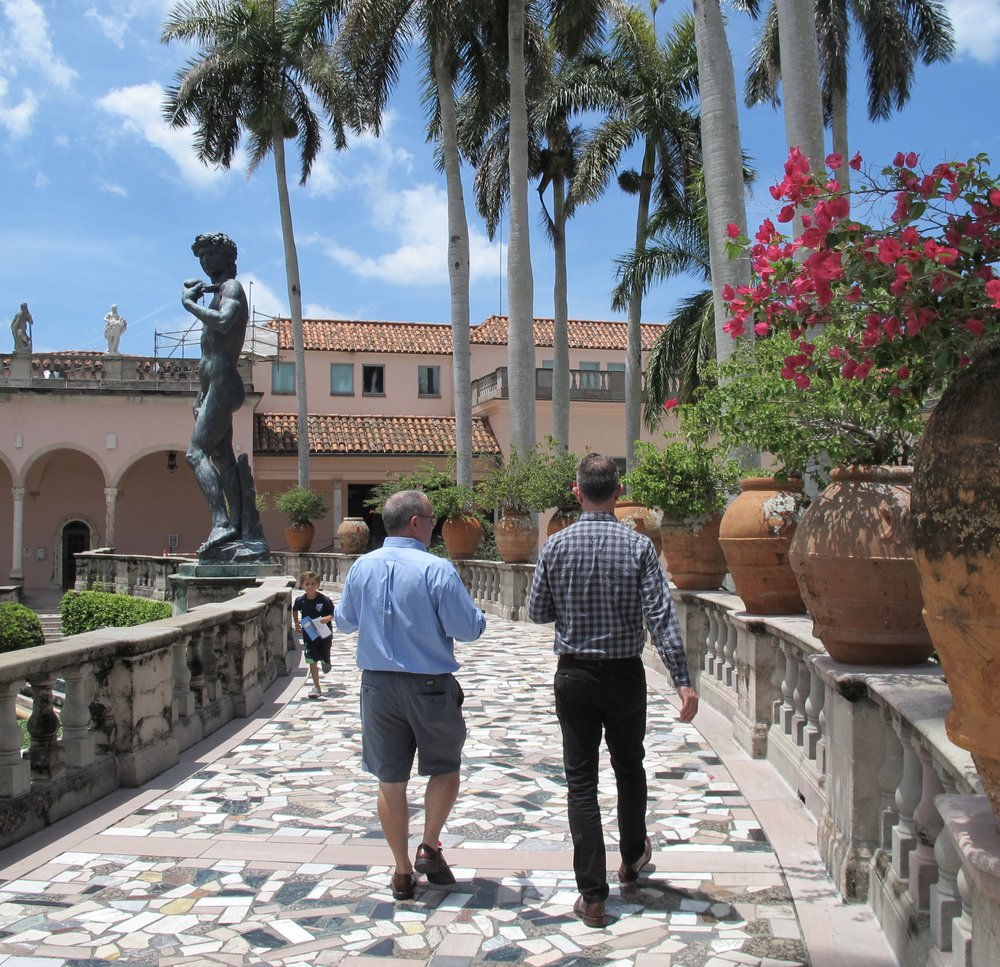 Curator Chris Jones (on rt) with Jose Gelats,leads visitors to Ringling's contemporary galleries across the stunning museum campus.