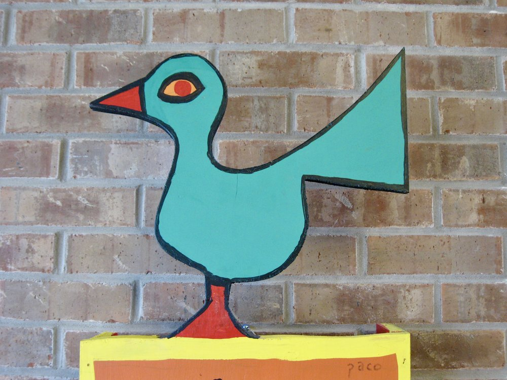 Top of a folk art piece by PACO Felici,  Bird on Stand