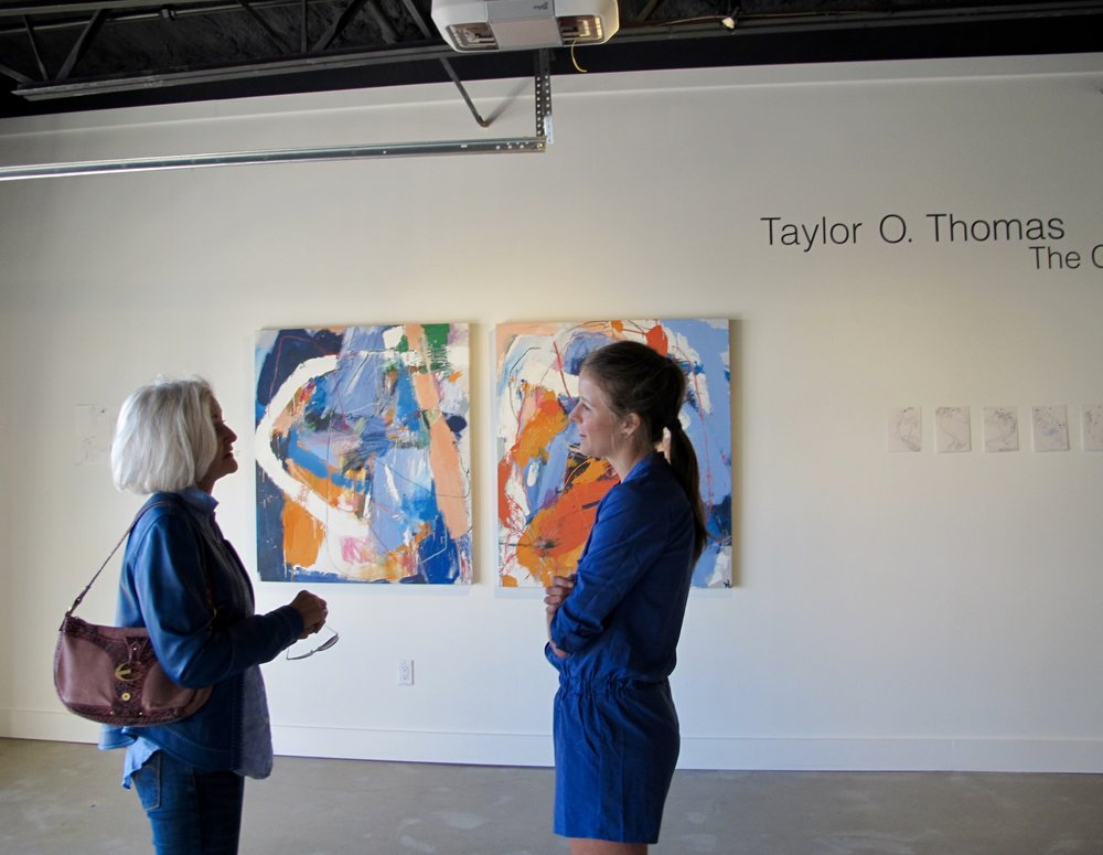 Painter Peg Trezevant talks with Taylor on Day One