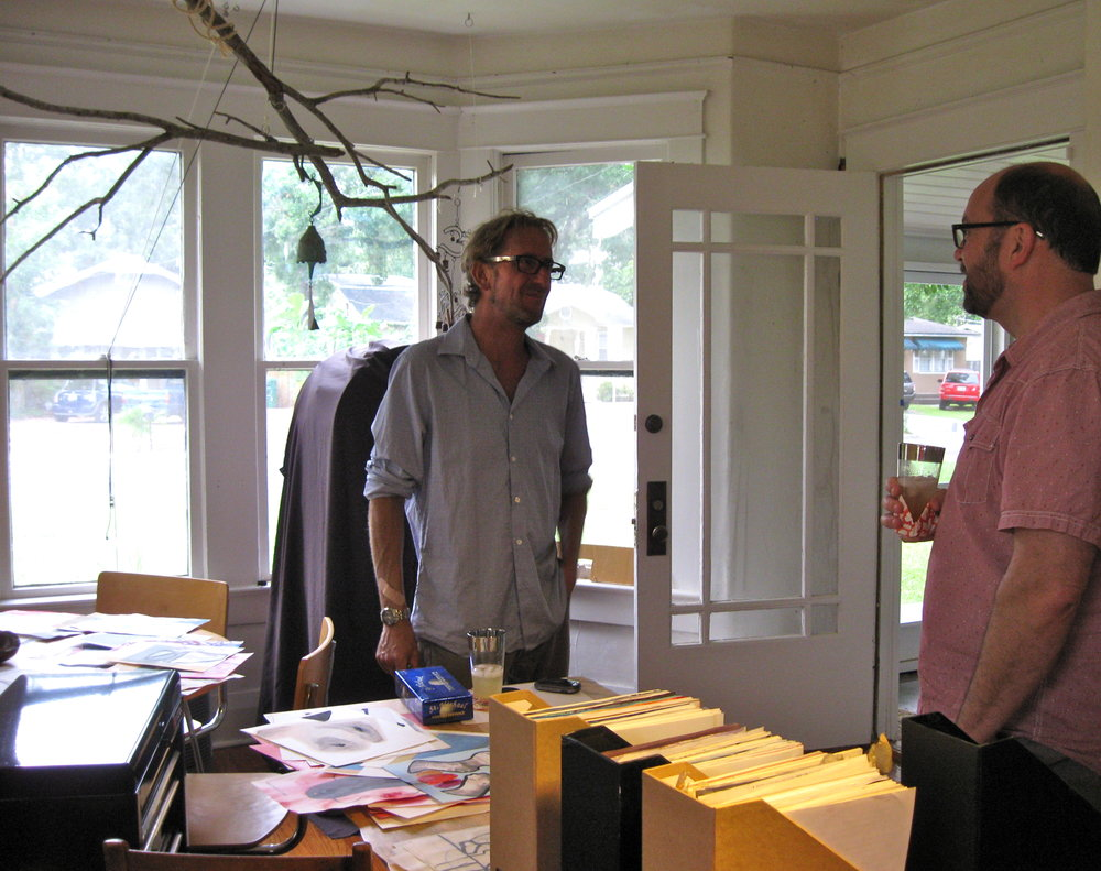 Selecting work with Designer Jeff Heidbreder while visiting home studio of artist George Anderton.