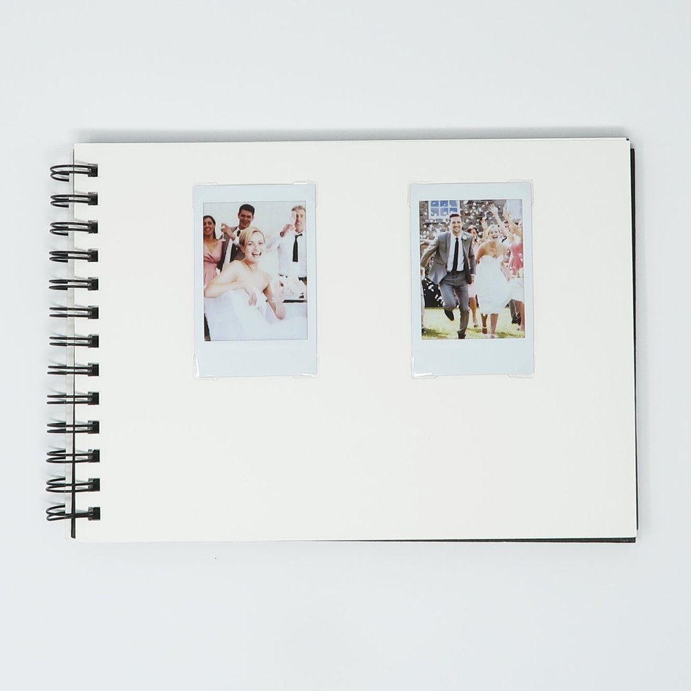 InstantCameraRental Guest Book 10%22 x 7%22 - Two Photo Per Page Centered Top.JPG