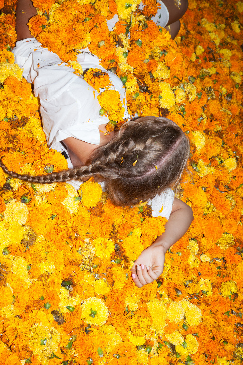 Girl with Braid surrounded with Flowers Carnations