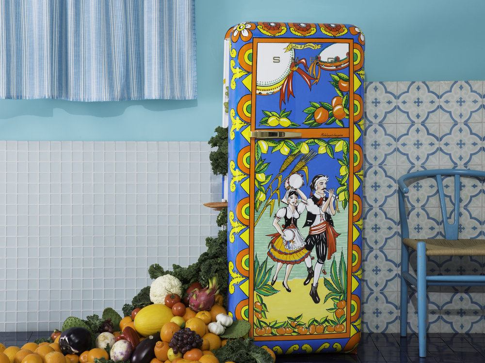 Dolce & Gabbana Refrigerator with Sicilian Design in a kitchen with absurd amount of fruit falling out