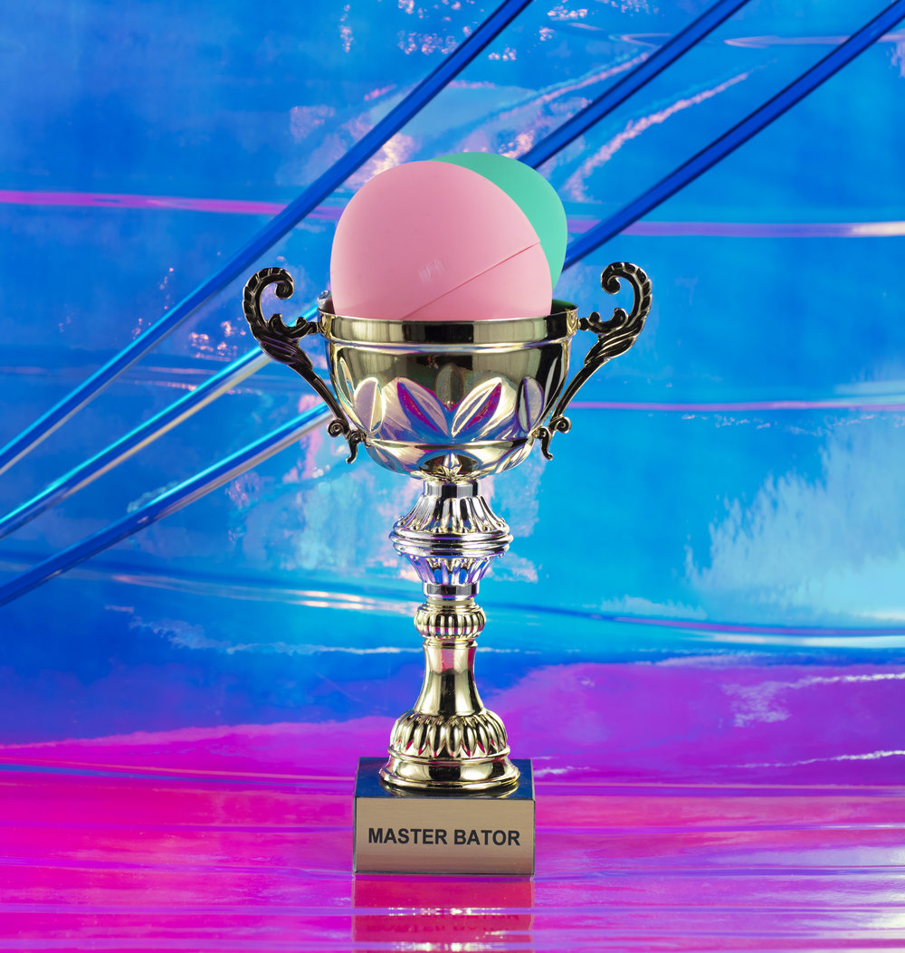 Masturbation Trophy filled with Sex Toys on an iridescent background
