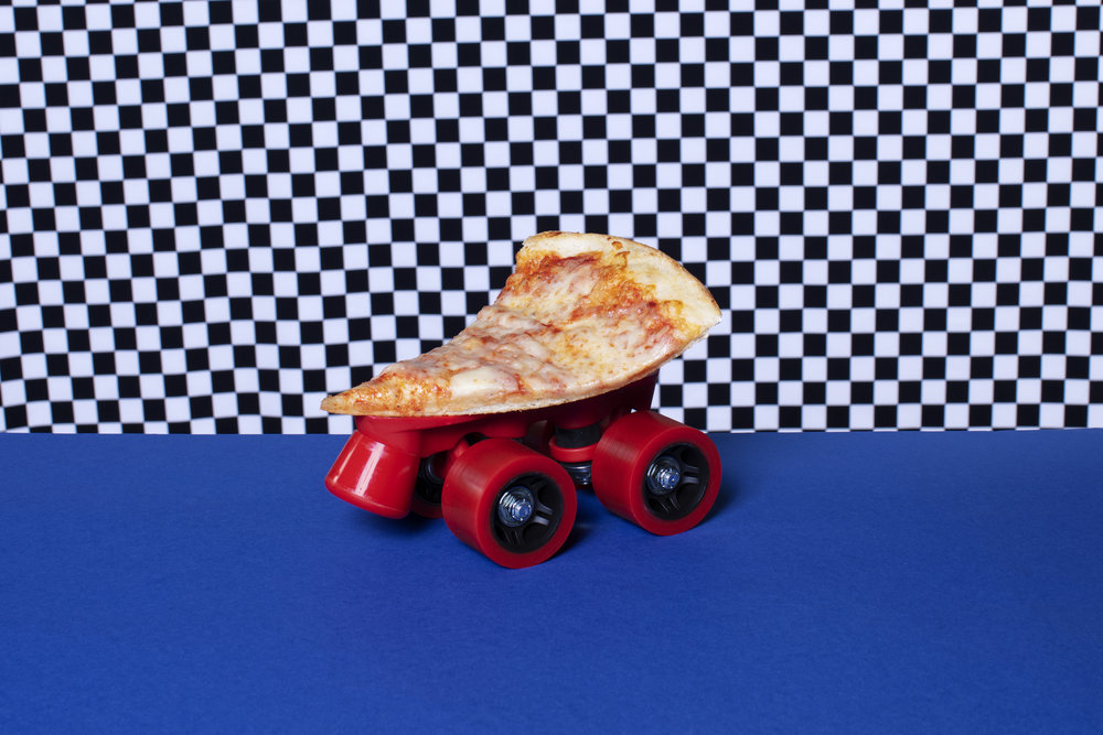 Slice of Pizza on Wheels with a check backgorund