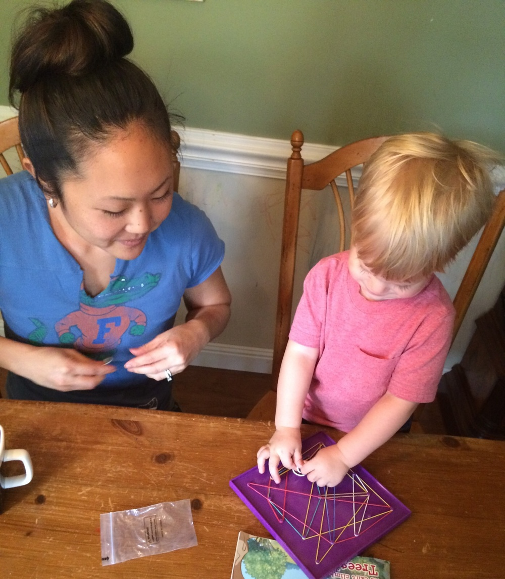 Aunt Yumi made a surprise visit for the first day of school! Lochlan is showing her his geo-board skills.