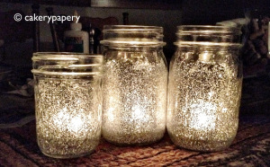 Invite Fairies into your life with glitter - try these mason jar candles from cakerypapery.