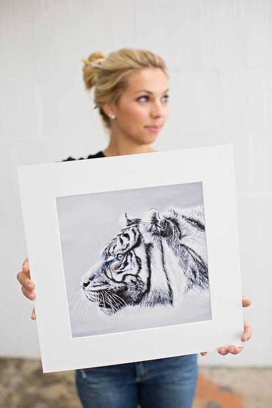 Ali Armstrong holding Sumatran tiger