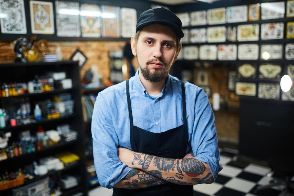 storyblocks-master-of-tattoo-art-in-his-salon_HUhWkUw0Z.jpg