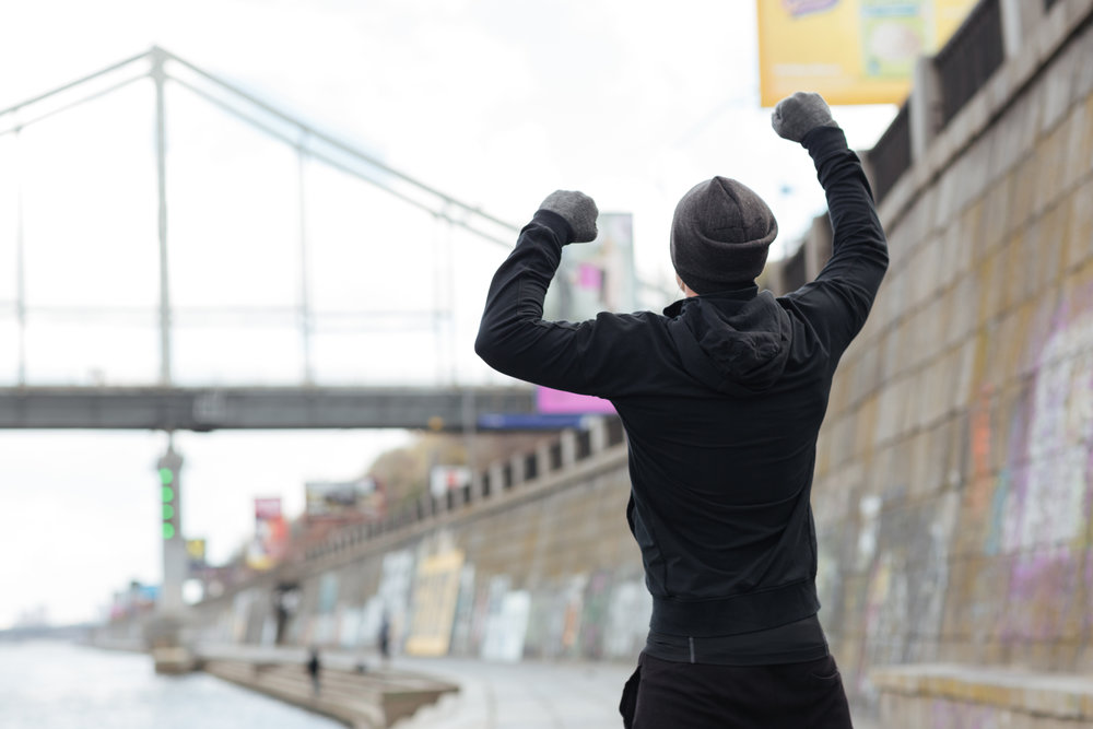 graphicstock-back-view-of-man-in-hat-and-gloves-standing-with-raised-hands-and-celebrating-success-outdoors_S8TlksPmO2g.jpg