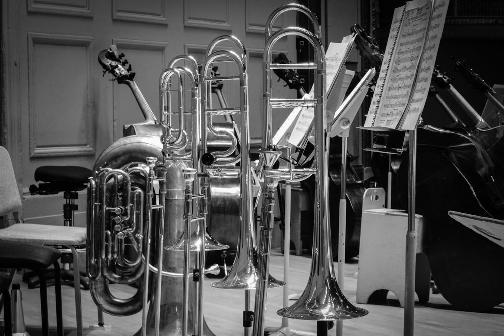 Tuba and Trombones at rest on rehearsal break between Bartok and Tchaikovsky.  (left to right) 1920's Holton BBb Tuba, Edwards B502-I Bass Trombone, Edwards T396-A with black valve cap, Edwards T350HB.