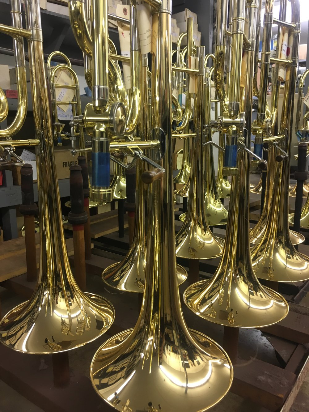 At the factory I get to see all the trombones before they're famous!