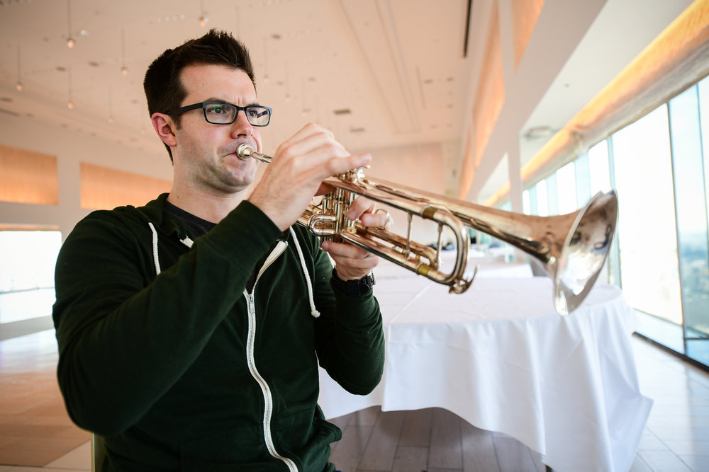 Associate Principal Trumpet, Tom Siders warms up at the beginning of day 1.