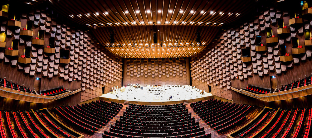 Dark stained wood enveloped our view at the Festival Hall, Shin-Asahi Building: Osaka, Japan